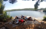 camping-laying-on-rock